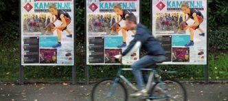 Kampen jongen op fiets